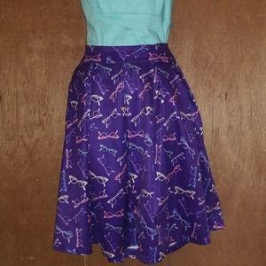 Purple and glasses print skirt